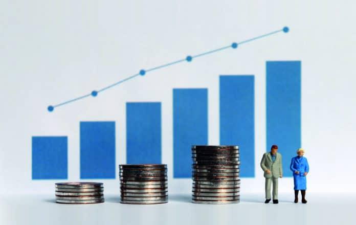 immagine che mostra un grafico in crescita, delle monete e due omini